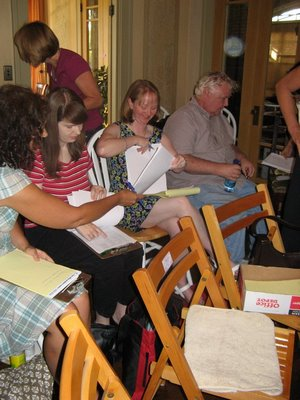 Liz Scanlon, Alison Dellenbaugh, Erin Edwards, Phillip Yates get their papers in order. April Lurie is in the background. (Photo courtesy of Cynthia Leitich Smith.)