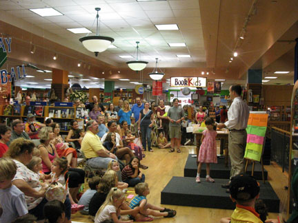 "A Glowing Moment for Picture Book Author Chris Barton and his many fans at his debut signing at BookPeople July 11 for ""The Day-Glo Brothers.""  Photo by Donna Bowman Bratton."
