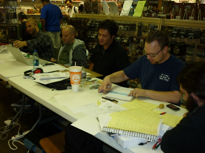 (L. to R) Bonn Adame, Erik Kuntz, Justin Rogers and Jeremy Guyton create at their table during 24 Hour Comics Day in Austin, Texas.