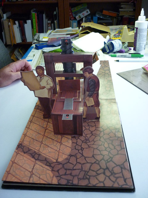 """""""Gutenberg's Gift"""" uses Bruce's paper sculpture to show how the first printing press worked."""