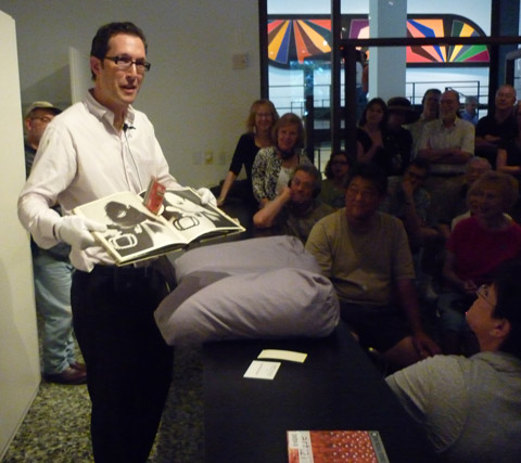 """Jon Evans of the Houston Museum of Fine Art shows a pop-up book made by Andy Warhol at a recent gallery talk, """"The Interactive Book."""""""