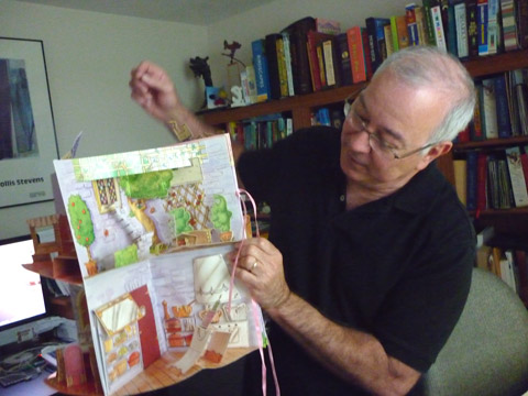 Bruce shows a dollhouse pop-up book