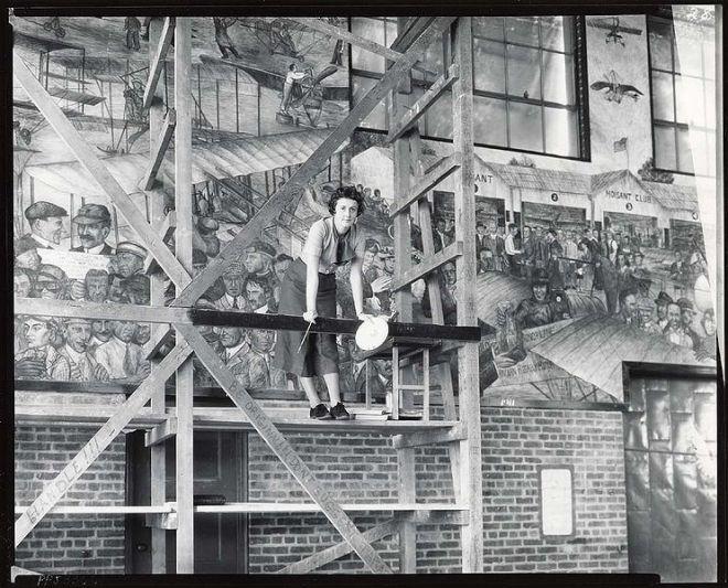 American painter Aline Rhonie working on wall mural
