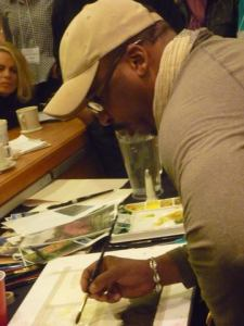 Earl Gradley Lewis demonstrates at the Austin SCBWI conference