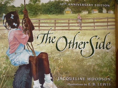 "The Caldecott Honor winning ""The Other Side"" by Jacqueline Woodson, illustrated by E.B. Lewis."